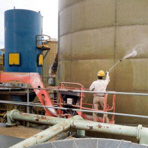 Pressure-washing the silo.