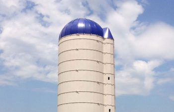 silo with new steel roof in blue