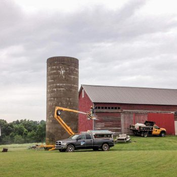 Washing the silo before its new paint job.