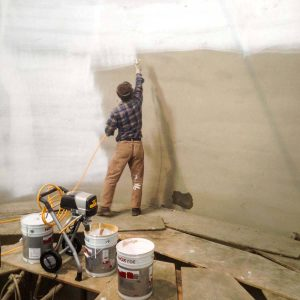 Painting/sealing the inside of a silo.