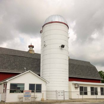 Dairy-barn silo after a new roof and coat of paint.