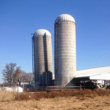 A leaning silo, about to be straightened.