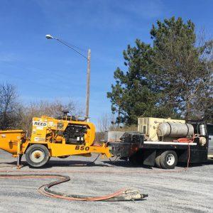 Concrete pumping/shotcrete rig.