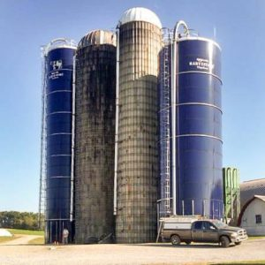 An operating dairy farm with several silo styles.